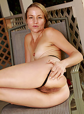 Elegant and blonde Gloria slips off her gown to reveal her hairy box