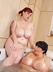 Hot Lesbian Titty Play In The Tub