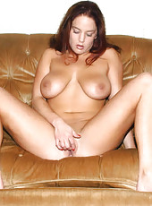 Gorgeous readhead plays with her 34d tits
