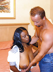 Busty african babe sucks the cock and gives an awesome titjob