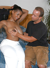 Ebony housewife with some heavy breasts touches self while giving a blowjob