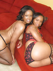 Two black hoes with lots of junk in the trunk sharing a black cock