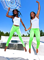 Two sexy ebony girls in neon tights with big tits and huge asses get a big cock work out