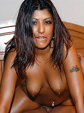Sexy and exotic brown babe rides white cock like a champ
