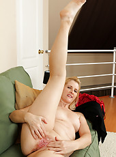 50 year old Jennyfer B from AllOver30 spreading wide on the couch