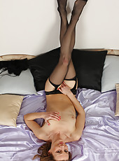 Bonde and horny Suzy Losson slips off her black lingerie and spreads