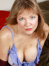 Horny blonde 52 year old Lilli looking hot as hell in her slinky blue lace