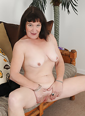 Elegant 50 year old AnnaD from AllOver30 shows off her bald pussy