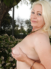 Big and busty Angelique from AllOver30 spreads wide outdoors