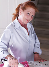 Cute mature redheaded housewife Tami Estelle breaks from her chores