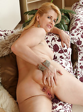 Gorgeous 50 year old Jennifer B from AllOver30 puts on a strip show