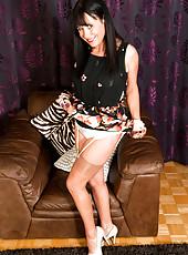 40 year old MILF Elise Summers slips of of her elegant dress here