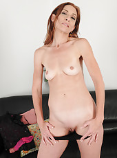 Petite and flexible Betty Blaze opens her 43 year old pussy wide