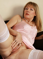 Gorgeous and elegant Lilli from AllOver30 posing in her lacy stockings