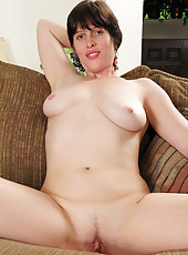 Short haired housewife Moxy slips off her lace and spreads in here