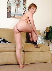 Petite 39 year old housewife Brandi Minx slips off her black fishnets