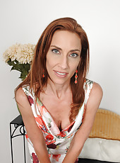 Thin 43 year old redhead Betty Blaze slips out of her elegant dress