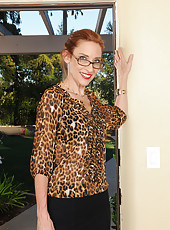 Skinny 43 year old Betty Blaze looking hot in her glasses and heels