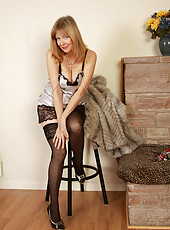 Elegant 52 year old Lilli showing strutting off her hot black stockings