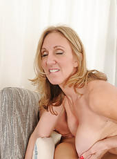 50 year old Jenna Covelli takes a big dick into her mature beaver