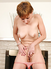 Petite 39 year old Brandi Minx from AllOver30 pulls on her shaved box