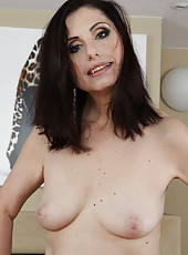 At 56 years old brunette Barbarella from AllOver30 is still sexy as ever