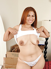 34 year old exotic MILF Alina breaks from her packing to do a strip tease