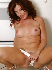 Jacqueline takes off her white panties and spreads her mature legs
