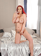 Redhead Tugs On Her Pierced Nipple