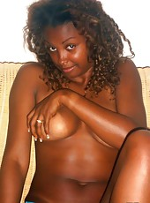 Photo collection of an amateur ebony babe showing her breasts
