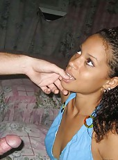 Pretty black chick giving her white BF a blowjob