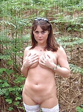 Wife strips outdoors and shows her shaved pussy