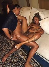 Inked up ebony slut sucking a big black schlong