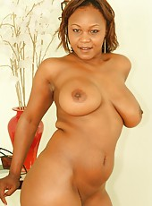 A busty ebony slut sucking cock like a pro