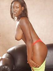 Horny Ghetto girl sucks on her huge black nipples