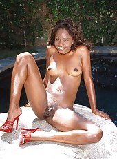 Horny black bitch with small tits spreads her legs