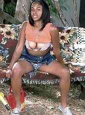 Black mamma teases by pinching her big nipples