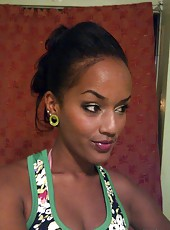 Gallery of a busty sexy black chick camwhoring at home