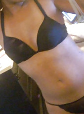 Slutty Ebony GF strips to expose her naked body