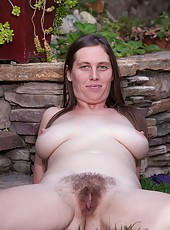 Lindsay is a busty and sexy Californian that loves being outdoors. She strips out of her blue dress and shows her hairy pussy. She plays with her breasts and fingers her hairy pussy with pleasure.
