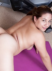 Hairy girl Daisy Leon is working on getting in better shape so after taking her morning run she comes home to her gym and then gets on the mats and gets naked and fingers her nice hairy pussy.