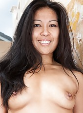 Max Makita is a sexy brunette beauty wearing her summer dress in the house. As she walks down the stairs she starts stripping out of her dress and lingerie and shows off her sexy hairy pussy and body.