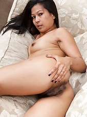Hairy woman Max Makita is a sexy Asian beauty wearing a black dress that she strips out of. And then she takes off her bra and panties and shows off her sexy hairy pussy as she spreads her lips apart.