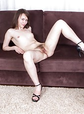 Sexy Mary dances off her yellow dress, showing her small breasts and her hard nipples. She spreads her legs, showing off a hairy pussy worthy of a hirsute porn.