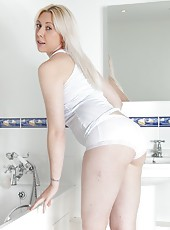 Alison Colins takes off her clothes and hops in the shower. She runs the water over her hairy pussy as it glistens in the light. She lathers up the soap and bends over to give a better view.