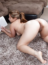 Daisy Leon has been reading this really good book. The book is so good that it gets her to strip to her panties and start rubbing her gloriously hairy bush