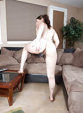 Jackie Paige slides her arm up to reveal her hairy arm pits, which she rubs softly. She slides her hands down her pits to her hairy arms, until she finally gets low enough to touch her hairy snatch.