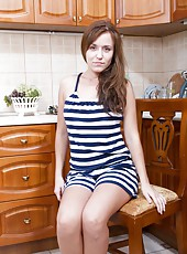 Hairy girl Era is a sexy brunette woman that loves to show off her sexy body. She is in the kitchen making a snack when the mood strikes and she slowly strips out of her clothes until she is naked.