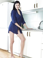 Hairy woman Mia is a sexy brunette that loves to show off her hairy pussy and she gets naked by the kitchen sink as she cleans the kitchen completely nude showing off her round ass and long legs.
