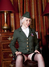 Alison Colins sits on a chair in a military uniform. She begins to strip down showing off her gorgeous stockings and purple lingerie. She spreads her legs and shows her perfect hairy mound.